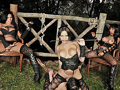 Three evil shemale dommes have their submissive boytoy tied up to a fence making him do everything they command. These three dommes take turns slapping him around, fucking his mouth and ass until they all three pull out and shower him with huge loads.