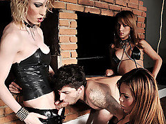 Mistresses Alicia, Erika, and Isabella do their best to put this submissive male in his place, worshiping at their feet.  They tie his uncut cock and ball sack before smacking it with a hard crop.  They then pump his ass and destroy his face with their cocks over and over again.