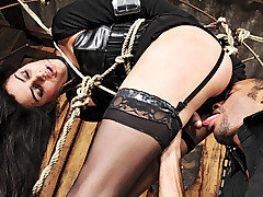 Poor Bianca wasn't quite prepared for the extensive punishment that this inked stud had in store for her.  He left her tied up and hanging for what she felt were hours upon hours. When he returned he showed her how those bounds would create the perfect fucking machine.