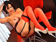 Thayna Louzada is a big cock tranny beauty from brazil that loves showing off her body in front of the camera. Watch this sexy ts doll dance around teasing in red and black lingerie before she finishes herself off by playing with her big hard veiny shemale cock.
