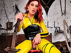 Jump into a real live comic book as you watch Joy Spears in her tight yellow latex.  She jumps right in with her sword at the ready to save you from a day of sexual boredom. You will blow your mind as you watch her stroke that cock in her latex, before exploding her cream.