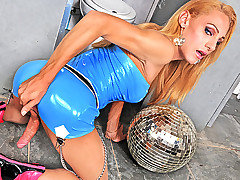 This drop-dead gorgeous shemale loves to party. Check her out in her tight blue latex dress. She was having so much fun at the club that she grabbed the glitter ball and ran! She took it into the bathroom and got all horny and worked up as she played with all her balls.