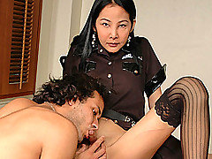 Oh is a hot tranny cop who's just arrested  James Mattarazzo. His punishment? He'll have to reach under Oh's skirt, feel around her panties for her cock and suck it! Officer Oh runs her fingers through his hair as James dutifully sucks off Oh to a hard and full erection. Then, planting her gently on a desk, James twists a finger up her butthole to see how tight her ass is. Laying her across the table in doggy-style, James pounds her gorgeous butt until he dumps his man curds all over Oh's face!