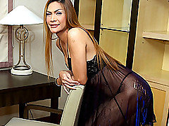 These sexy shemales just keep getting hotter and hotter!  In this fantastic ladyboy video, blond transsexual MILF Justine shows off her still hot body and large, quivering cock.  This babe is certainly not a coed any longer, but she is just growing more magnificent with each passing year!  She is the kind of experienced and dominating bitch who would just hold you down and pound you in the ass just like you need it.  However, unfortunately in this video she doesn't have a man to please her, so instead she strips and sits on the edge of her desk, stroking her long thick cock until she spurts all over her own stomach and hard shaft.