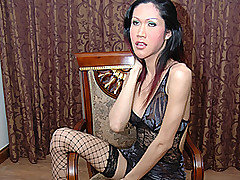 Busty, big cock Asian transsexual Lek is the kind of girl that most red blooded males would gladly pay money for!  She's got a perfect body along with that classic long black Asian hair; her huge fake tits are topped off by an incredible cock!  Not many Asian trannies have got a whopper this big lurking in their pants, but Lek's dick is definitely larger than life!  Her pubes are neatly trimmed, which only serves to make that thick schlong look even bigger.  She squats spread legged on a chair, showing off her sweet pussy and that incredible erection.  Her dick points straight to the ceiling, quivering with life and dribbling hot sperm.