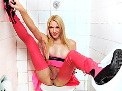 Laviny is one nasty shemale that just took over the public bathroom in her hot pink latex dress and skin tight leggings. She loved teasing her monster cock in the bathroom stall until it grew to its full potential and then she dropped that she dick into her hands to jerk it until it cums.