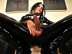 Ts Luciana Foxx is an extremely sexy shemale babe but I have never seen her look as sexy as she does in this update. Check her out in this tight black full bodied latex suit and high heels! If you like that, just wait until you see her whip out that amazing shecock of hers!