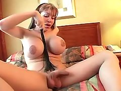 Busty shemale plays w cock and cums