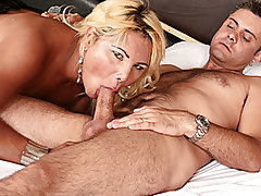 Ricardo Wandley likes it on the kinky side. He met up with Shirley Wandley, a blond and busty tranny, and took her back to his room. He had never had his cock sucked like she sucked it. It felt so good he couldn't hold out so he put her on her hands and knees and drove his dick into her from behind. She jacked herself off while getting plowed by him then she got on top so she could take it really deep. He was balls deep in her ass, her dick bouncing off his belly when he had to cum so he pulled out and came in her mouth and she returned the favor, shooting her load into his.